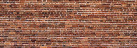 Red Brick wall background. Wide panoramic view of masonry. Grunge red masonry texture. Imagens