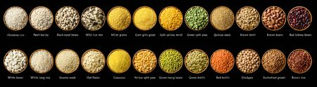 Big set of legumes and cereals in wooden bowls isolated on black. Food background, header, banner. Top view