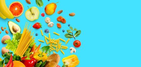 Fresh healthy food vegetables and fruits. Groceries on aqua blue background. Top view Reklamní fotografie