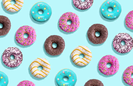 Delicious doughnuts pattern on a mint background. Top view. Flat lay