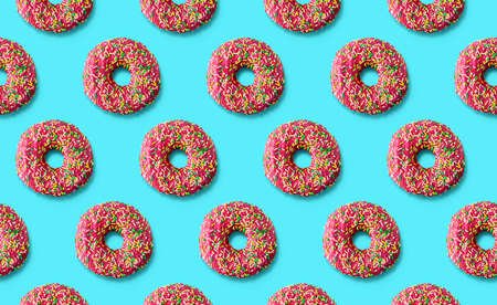 Donuts pattern on a mint cyan background. Top view. Flat lay. Summer concept