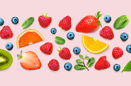 Fruit and berry pattern of various ripe berries and leaves on pink background. Fruit border frame banner. Flat lay.