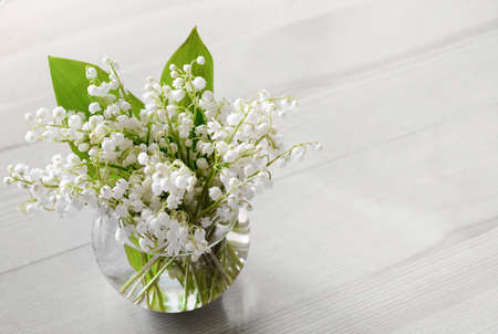 Bouquet of lilies of the valley on the white table 版權商用圖片 - 152267887