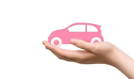 Pink toy car in womens hand on a white background. Car purchase concept