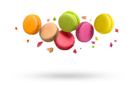 Macarons sweet bakery falls with crumbs isolated on white background.