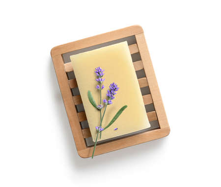 Natural homemade lavender soap with lavender flowers on wooden soap dish on white background. Top view. Flat lay 版權商用圖片