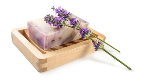 Homemade natural lavender soap on wooden soap dish isolated on white.