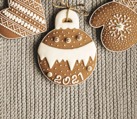 Homemade gingerbread on knitted woolen fabric background