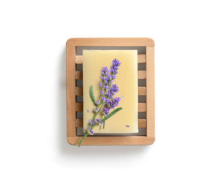 Homemade lavender soap on wooden soap dish isolated on white background. Directly above 版權商用圖片