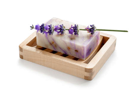Lavender soap on wooden soap dish isolated on white.
