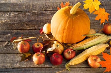 Autumn composition with autumn pumpkin apples corn on the wooden table Banco de Imagens
