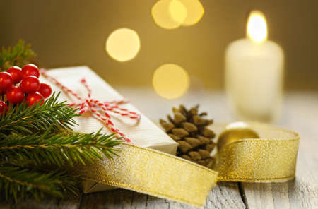 Christmas composition with gift box pine cone fir branch and burning candle