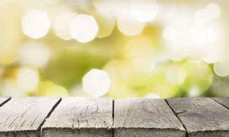 Empty rustic wooden table top in front of abstract blurred lights background 版權商用圖片