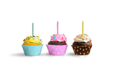 Birthday cupcakes with candles on a white background