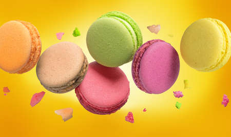 Colorful Macaroon sweet bakery on yellow background.