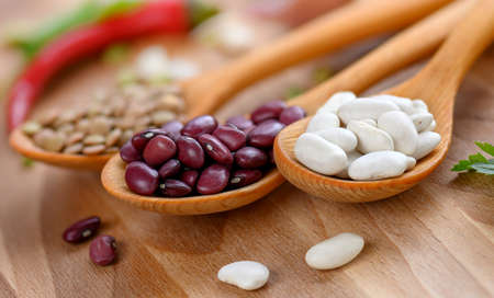 Healthy legume family seed in wooden spoons