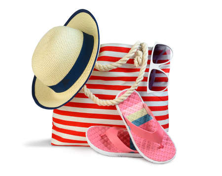 Beach bag with accessories isolated on white 版權商用圖片
