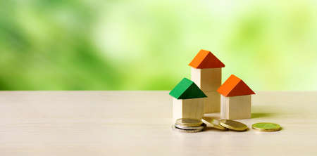 Small wooden houses and euro coins. Real estate investment concept