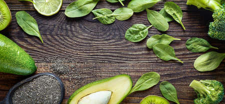 Healthy eating concept with avocado, chia seeds and spinach leaves, broccoli. Background, banner