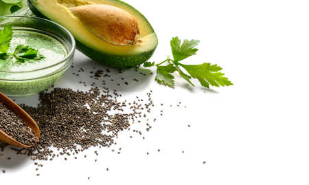 Chia seeds in wooden scoop with Green smoothie and avocado on white background 版權商用圖片