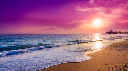 Purple Sunset on the beach in tropical resort