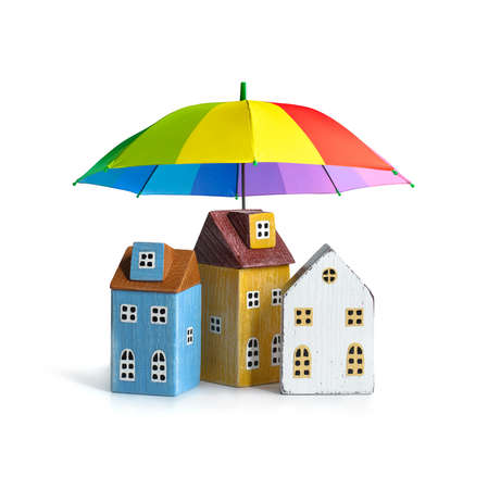 Houses covered by umbrella isolated on white. Real estate security concept. Free space
