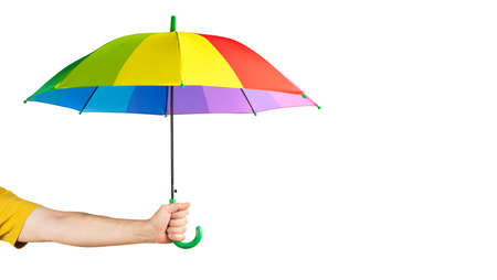 Hand holding Multicolored umbrella isolated on a white.