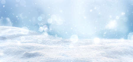 Winter snow background with snowdrifts. Snowy landscape with beautiful bokeh lights and snow flakes. Layout for design 版權商用圖片