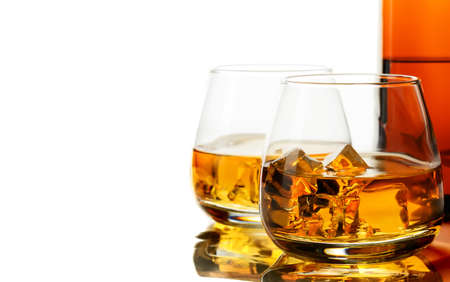 Glass of whisky and ice on a white background