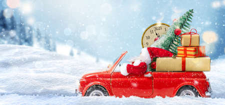 Christmas is coming. Santa Claus in red toy car delivering gifts for New Year 2021 版權商用圖片