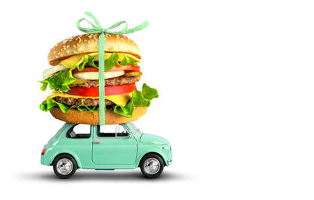 Toy car delivering fast food order hamburger isolated on white 版權商用圖片
