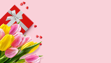 Mothers day greeting card with tulips bunch and red gift box on pink background.