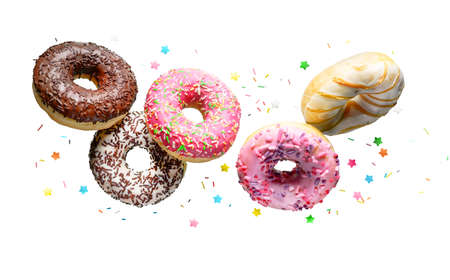 Flying donuts isolated on a white background. 版權商用圖片