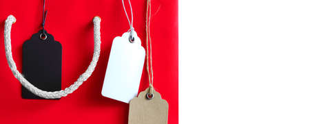 Price tags on red shopping bag on a white background