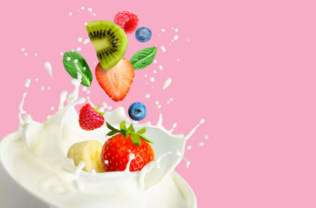 Fruit and bery mix falling into the bowl with milk and splashing on a pink background. Standard-Bild