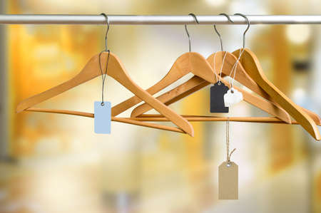 Empty hangers with price tags in the store after sale Standard-Bild