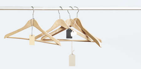 Empty hangers with price tags after a big sell-off in the store on white. Big final sale concept with copy space