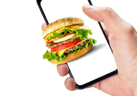 Hand holding phone with hamburger on screen isolated on white background. Online ordering fast food.