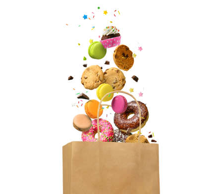 Donuts, cookies, macaroons and other sweets falling in paper bag isolated over white background. Sweet bakery, pastries, confectionery concept background.