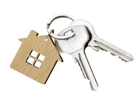 House key pair with house shaped keyring isolated on white background. Top view.