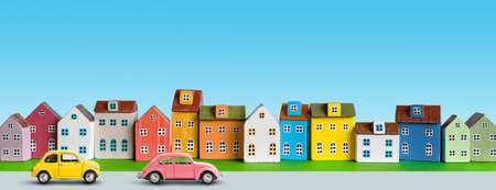 City scene with row of cute houses along the street and retro toy cars.