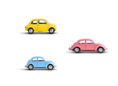 Miniature retro toy cars isolated on white Standard-Bild