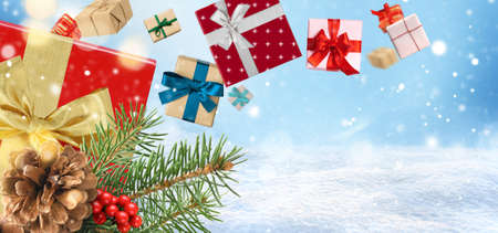 Christmas presents or New Year gifts on a blue snowy background. Card or invitation. Copy space