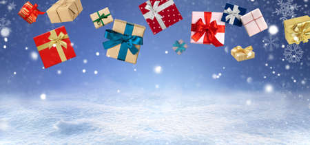 Christmas presents or New Year gifts over blue snowy background. Card or invitation. Copy space
