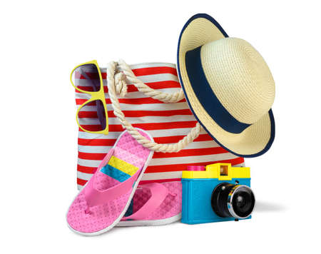 Beach bag with accessories isolated on white 写真素材