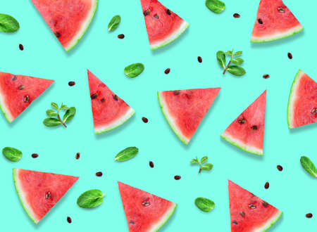 Watermelon slices with fresh mint leaves pattern. 写真素材