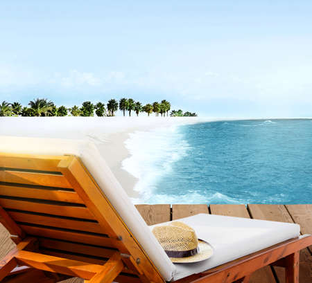 Beach lounger on wooden deck terrace on the beach with beautiful seascape lagoon and palm trees 写真素材