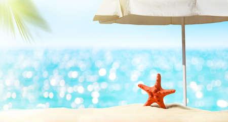 Summer vacation background. Sea, sand beach, umbrella