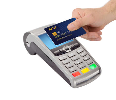 Hand hold bank card near pay terminal isolated on white background . Contactless payment, paypass.