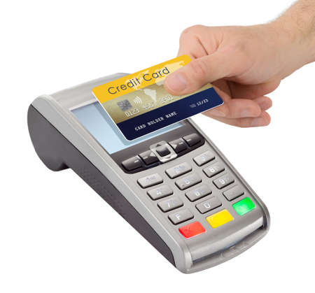 Male Hand holding credit card near pay terminal isolated on white background.